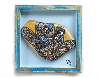Hamsa painted stone in wooden frame ready to hang, painted rocks