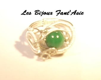 Ring wire wrapped in copper wire and green and white glass beads