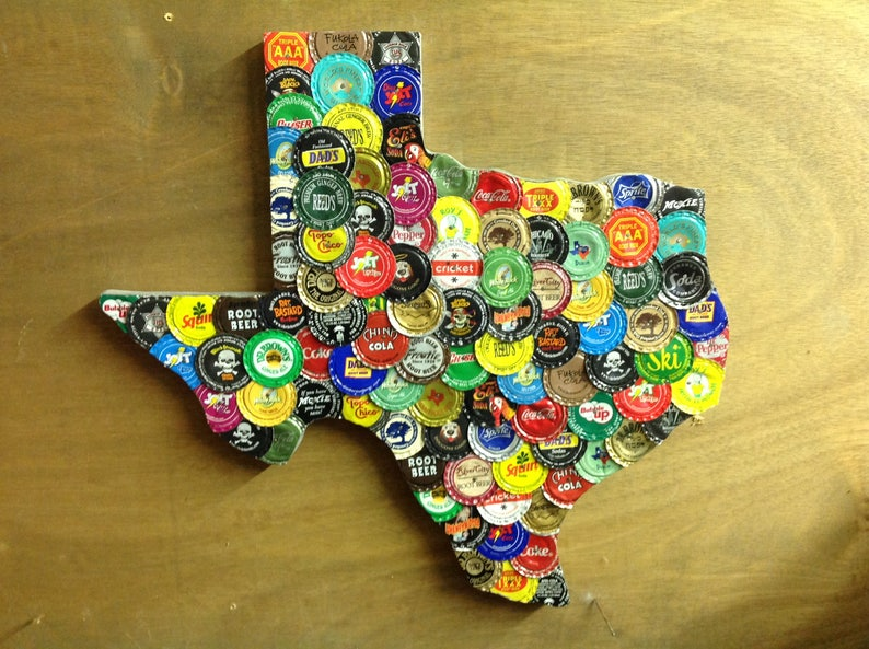 Multiple Soda Bottle Caps on Texas Outline Game (which cap has only one?)  15 by 16 inches (#2)