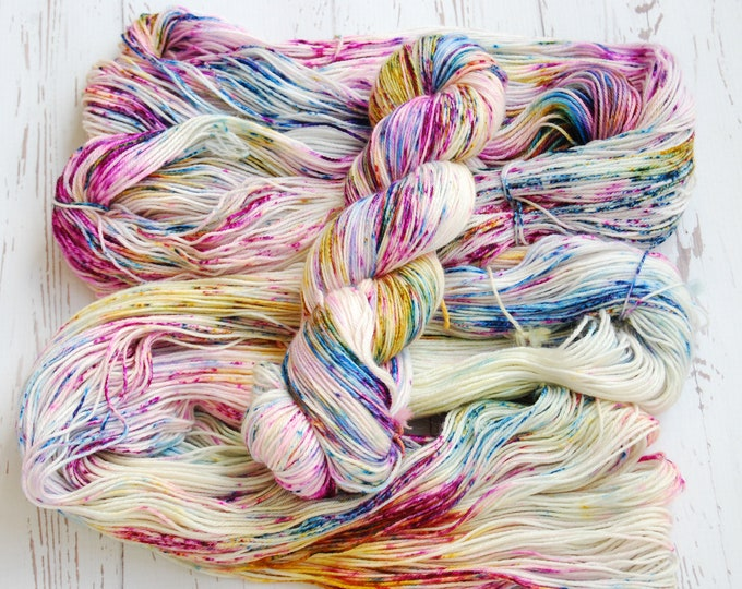 Featured listing image: Jubilation - Hand dyed speckled yarn in Blue, Gold, Pink, Purple