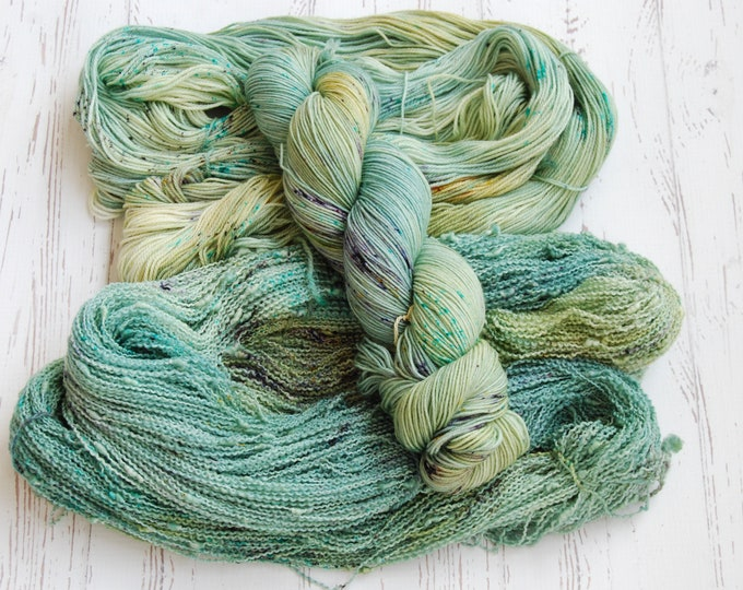 Featured listing image: Fields of Hyrule - Fingering - Hand dyed speckled yarn in Green, Gold, Purple, Blue, Brown