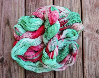 LED Lights - Hand dyed variegated yarn on a light green base with emerald green and vibrant red speckles - Christmas themed yarn
