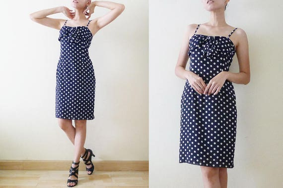 1980s navy and white polka dot party dress with full skirt and bow detail