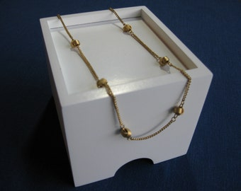 Delicate Knot Gold Tone Necklace by Avon 60's