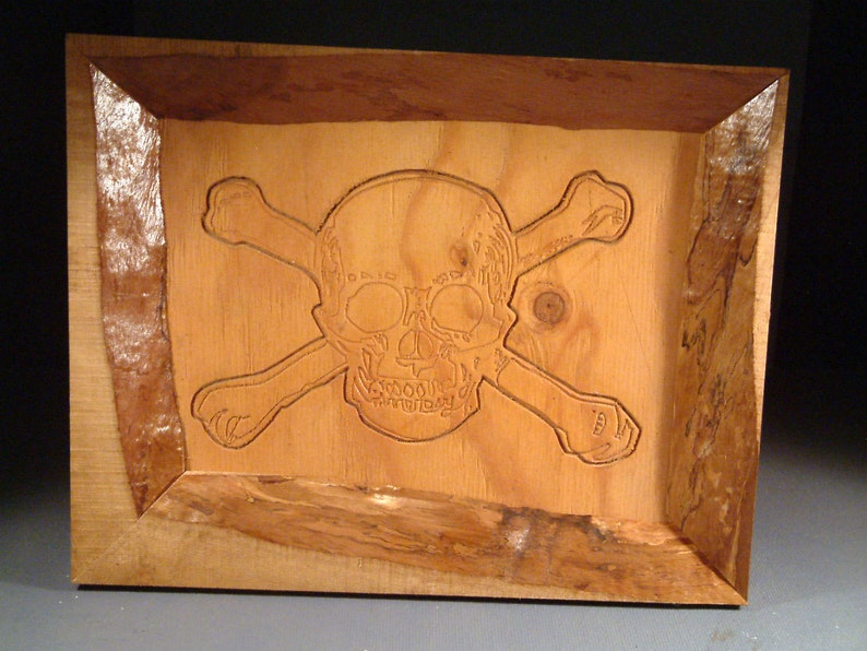 Skull & Bones in a Natural Edge Frame image 0