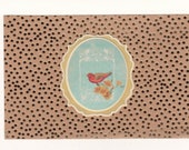 Gold Patterned Card Kraft Paper & White Cardstock with Hand Applied Bird, possibly a Purple Finch atop tiny wildflowers.
