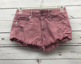 Vintage distressed blush denim shorts
