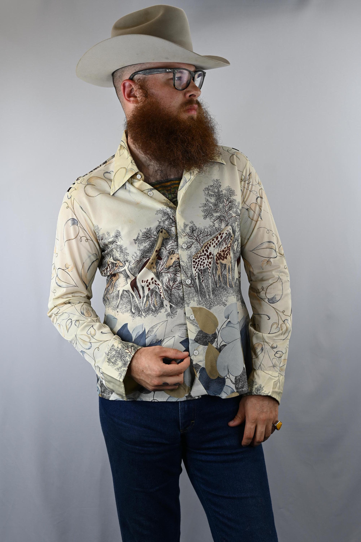 1970s Mens Shirt Styles – Vintage 70s Shirts for Guys Vintage 1970s Mens Brigade Animal Print Picture Shirt Size Xl $24.00 AT vintagedancer.com