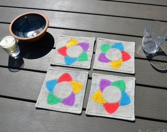 Rainbow drinks coasters. Hand sewn and sashiko quilted multicolour coasters or display mats. EPP. Machine washable reversible UK
