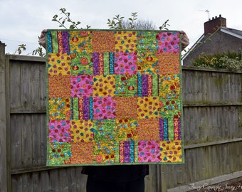 Colourful bugs and critters baby quilt / baby blanket. New baby cot quilt. Bright colourful sensory patchwork quilt. Vibrant Square quilt UK