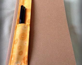 Journal pen holders