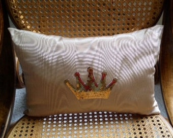 Moire pillow with gold crown applique