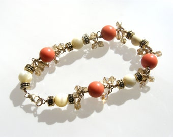 Tropical Chain bracelet - coral and ivory beads with swarovski dangles with gold chain.