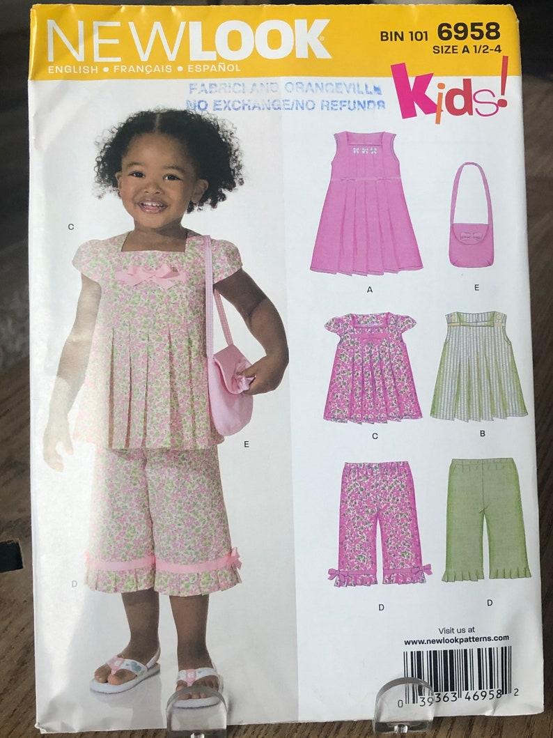 6958 NEWLOOK 2010 Vintage Children\u2019s Sewing Pattern Toddler Girls Clothing size 12-4 UNCUT