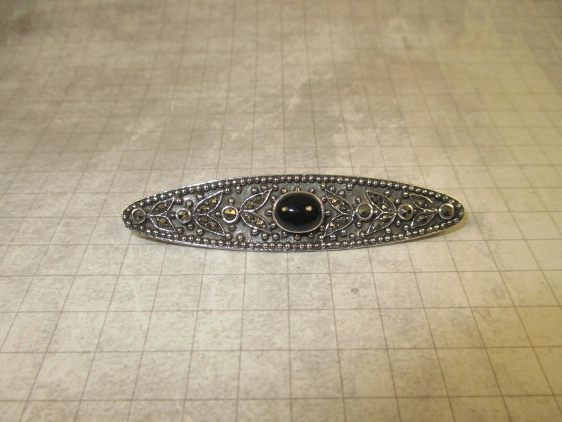 Antique Onyx and Marcasite Brooch