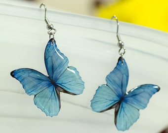 Blue Morpho butterfly earrings, translucent. Looks like real butterfly. Comes in a gift box.