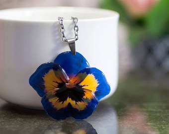 Pansy necklace with jewelry box included. Dark blue and orange flower necklace.