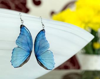 Blue morpho butterfly wing earrings looks like real butterfly. Comes in a gift box.
