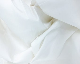 Silk shantung in creamy antique ivory color, machine loomed