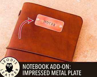 Notebook add on: impressed metal plate