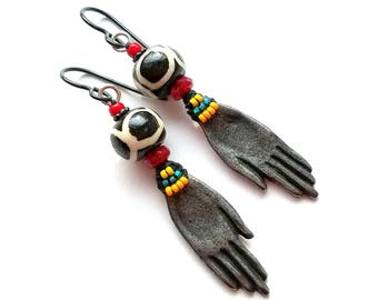 Tribal, rustic earrings, African beads, artisan-made dark pewter hand charms, whimsical, red Czech glass, yellow/orange/green, lightweight