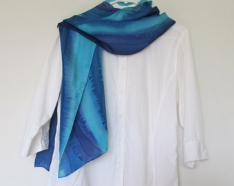 Hand painted, approximately 11 x 76 inch, 100% silk scarf in turquiose and blue.