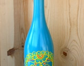 Day of the Dead Wine bottle Vase, Up Cycled, Brightly colored, Turquoise, yellow, green and orange