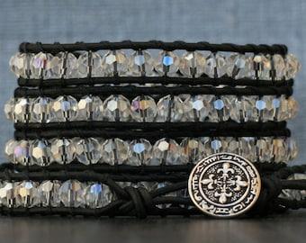 bohemian jewelry - wrap bracelet- clear aurora borealis crystal on black leather- beaded leather - boho gypsy glam rainbow