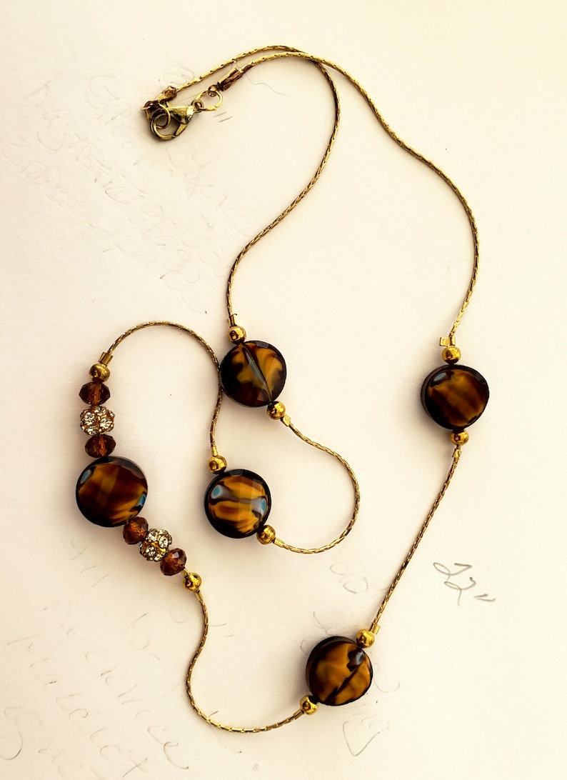 22 inch costume jewelry necklace in brown  umbers and gold image 0