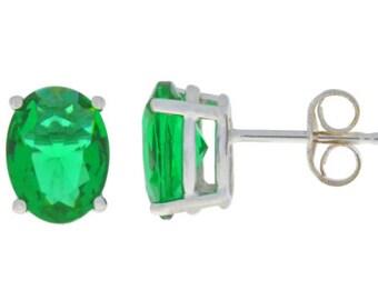 14Kt White Gold Emerald Oval Stud Earrings