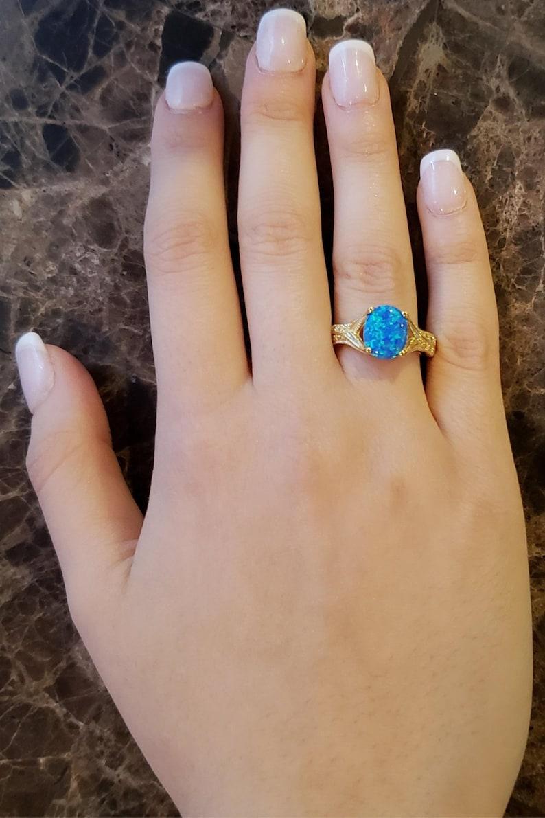 14Kt Gold Blue Opal /& Diamond Oval Ring
