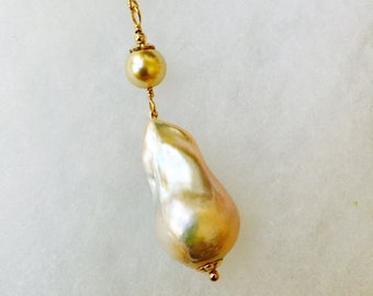 Long gold and pearl drop necklace