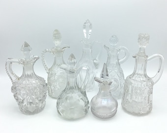 Collection of 7 Vintage Cut Glass Cruets