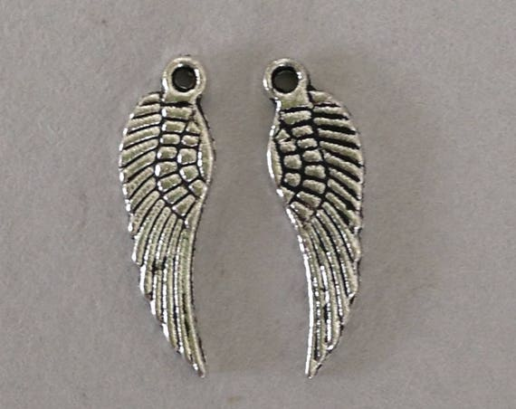 Double sided antique Silver tone angel wing charms perfect for custome jewelry and fund crafts