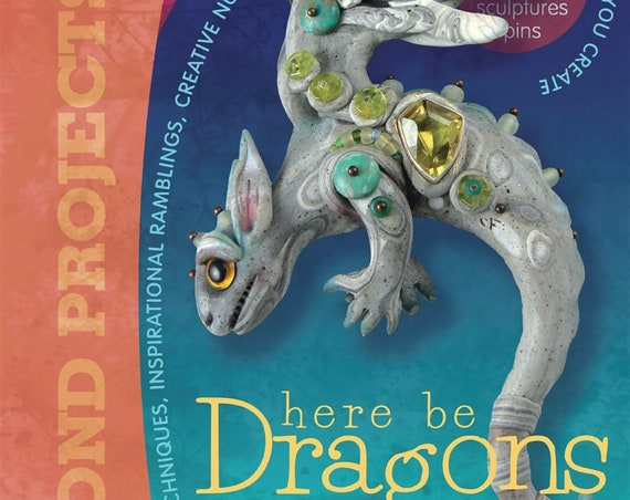 Dragons with Christi Friesen's book, Sculpting Draons and other Mythical Creatures out of Polymer Clay and other mixed media.