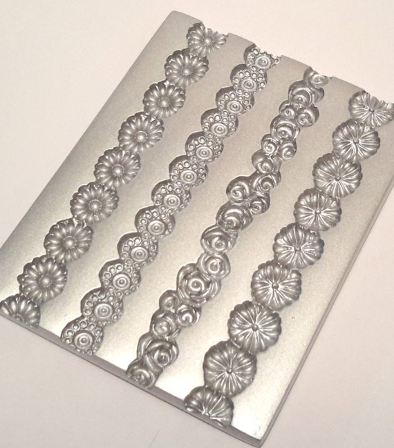 Daisy Chain border mold, by lisa pavelka perfect for adding a accents and trims to your polymer clay creations.