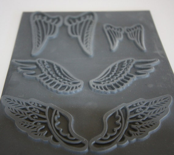 Feather Wings Unmounted stamp great for polymer clay and other crafts designed by Christi Friesen
