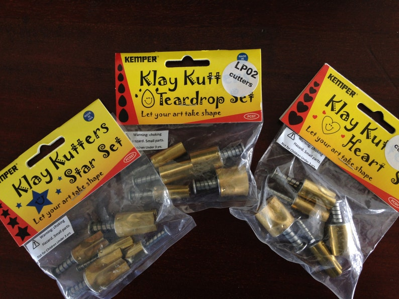 Plunge style cutters by Kemper 76 Piece teardrop triangles and more Klay Kutters square stars round