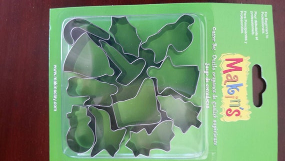 "12 piece Christmas cookie cutter set with sizes from 7/8"" to 1-3/4"" tall helps you celebrate the holidays"