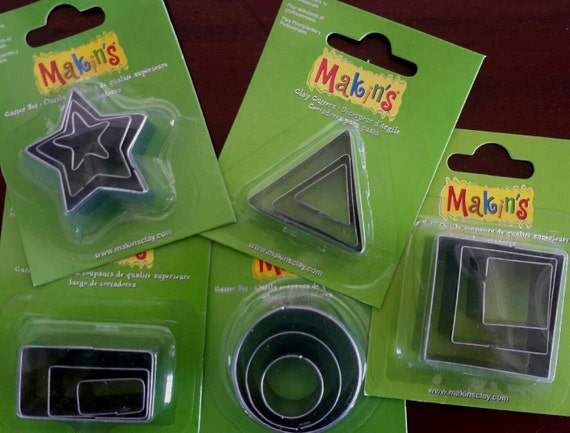 "15 piece geometric cookie cutter set with sizes from 7/8"" to 1-3/4"" tall perfect for jewelry and art projects"