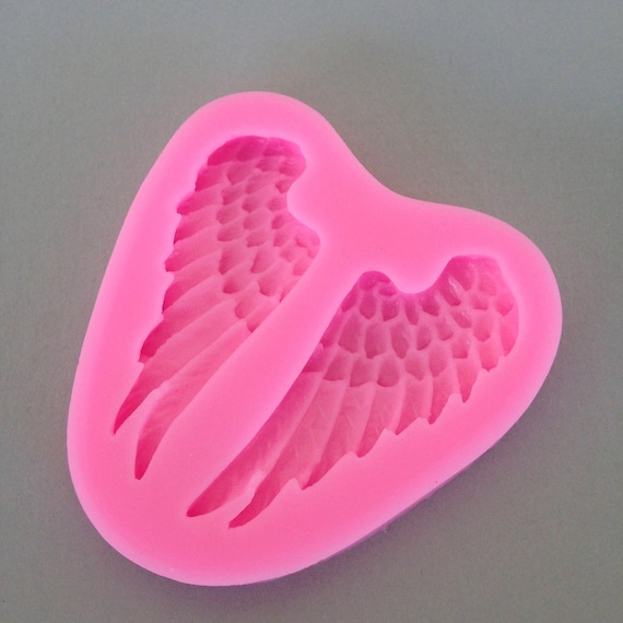 Beautiful angel / fairy wings food safe Silicone mold perfect for fondant, polymer clay, chocolates, candy, soap resin work and much more.