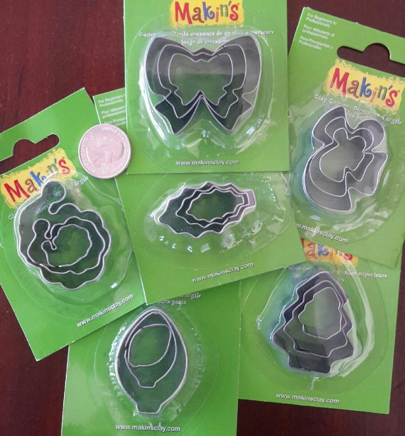 "30 piece holiday cookie cutter set with sizes from 7/8"" to 1-3/4"" tall"