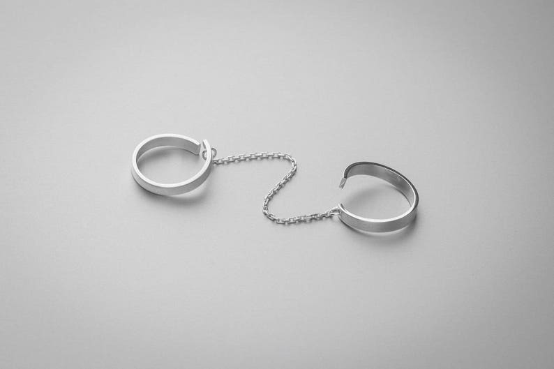 sterling silver Adjustable knuckle set of two rings with a chain
