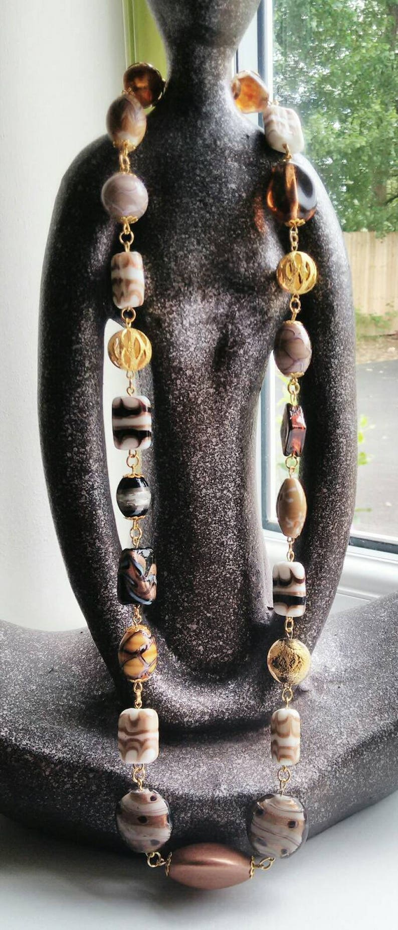 Neutral beaded necklace made with a variety of quality beads
