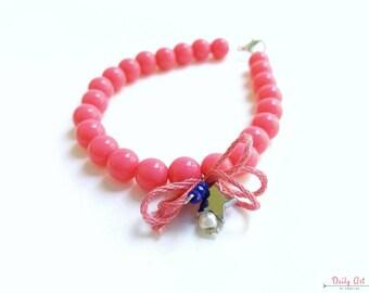 Fuschia, hippie, beaded bracelet