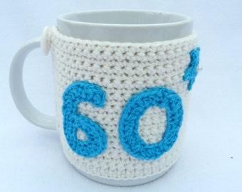 Crochet. 60th Birthday cream crochet mug cosy. Home wares, birthday gift, accessories, 60th birthday gift gift for him, gift for her.