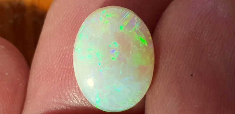 Oval Opal Cabochon from Lightning Ridge 13 x 10 mm approx.Item 1654