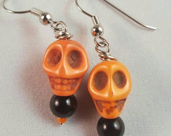 Orange skull earrings with black and orange beads accents