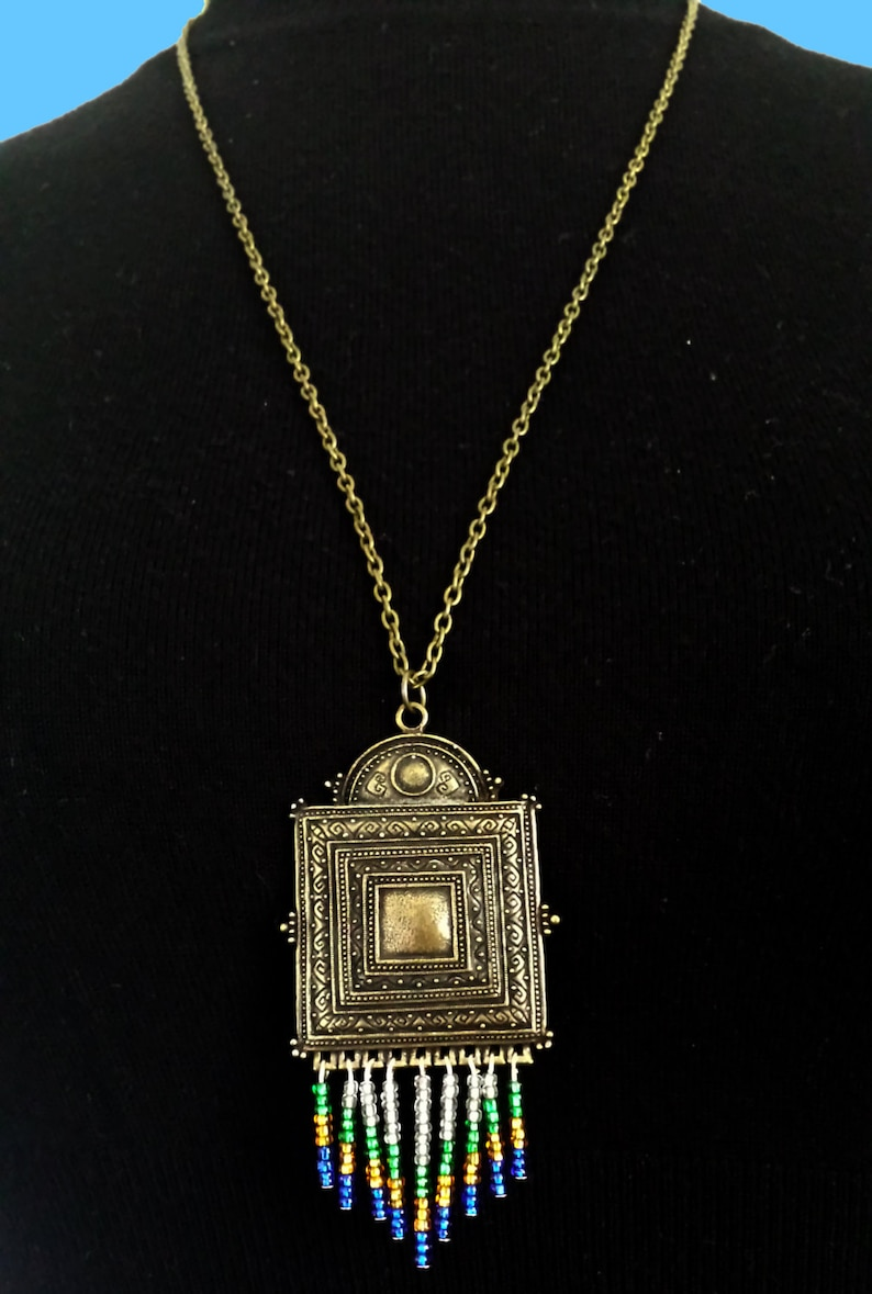 Ornate square charm necklace with beaded detail image 0