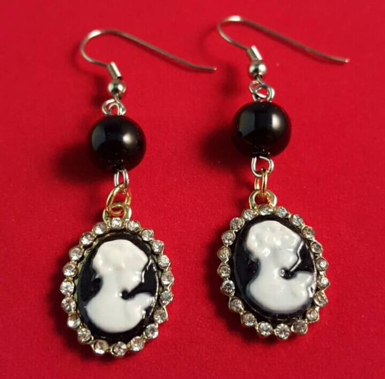 Dangle black and white cameo earrings embellished with image 0